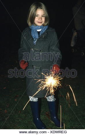 Child celebrating Guy Fawkes playing with sparklers - Stock Photo