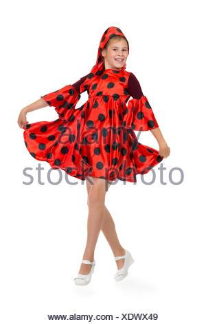 Girl dancing in a red polka-dot dress - Stock Photo