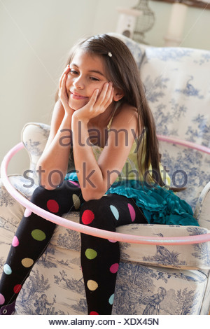 girl sitting on chair - Stock Photo