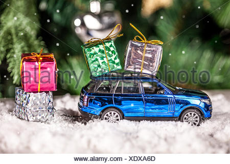 A toy car and Christmas gift - Stock Photo