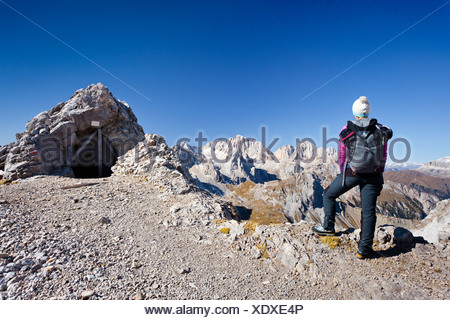 Hiker on Costabela Mountain while using the Bepi Zac climbing route in San Pellegrino Valley above San Pellegrino Pass - Stock Photo