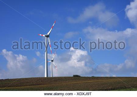 Wind turbines against blue sky, Rhena, Mecklenburg-Vorpommern, Germany - Stock Photo