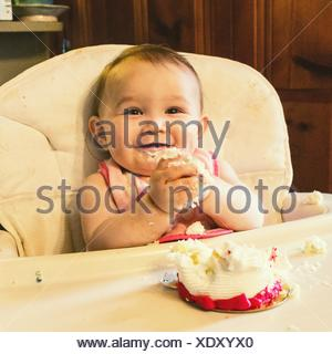Portrait Of Cute Baby With Messy Hands At Home - Stock Photo