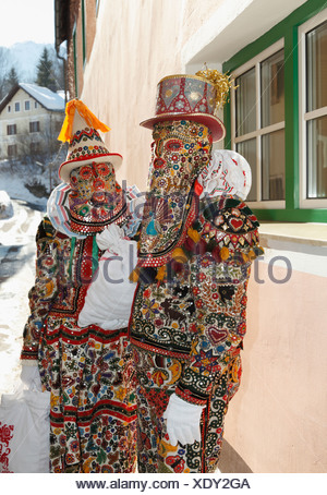 Pair wearing Flinserl costumes, spring figures of the Ausseer carnival, Carnival in Bad Aussee, Ausseerland, Salzkammergut - Stock Photo