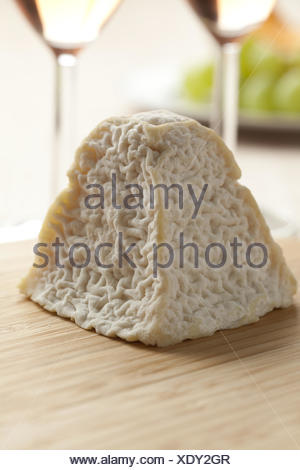 Fresh Pouligny St. Pierre cheese for dessert. - Stock Photo