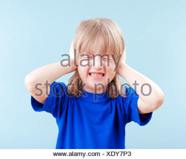 boy covering his ears - Stock Photo