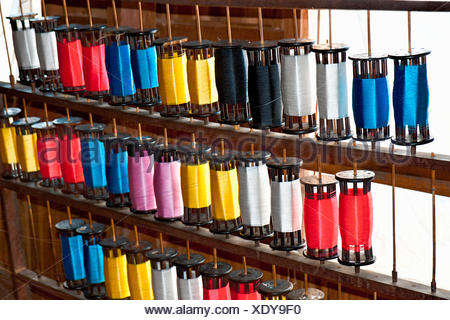 Bobbins of threads in a weaving mill, near Inle Lake, Myanmar, Burma, Southeast Asia, Asia - Stock Photo