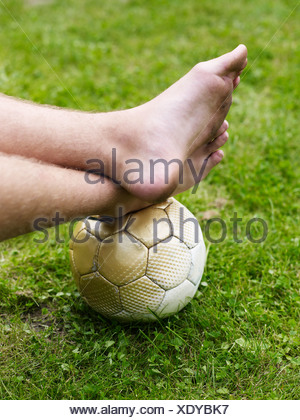 Bare foot on soccer ball - Stock Photo