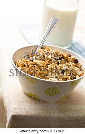 food aliment health sweet lifestyle grain milk diet wheat dry dried up barren corn dish meal morning raisins vegetarian mix - Stock Photo