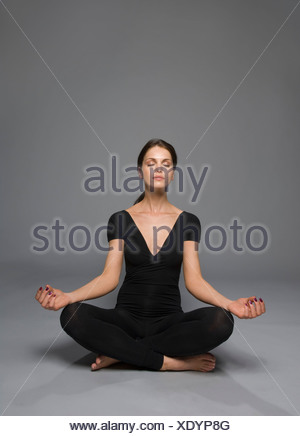 female beauty in catsuit yoga position - Stock Photo