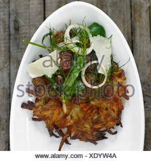 Plate of potato pancake with toppings - Stock Photo