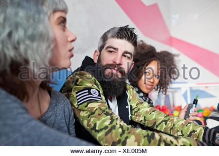 Young friends smoking - Stock Photo