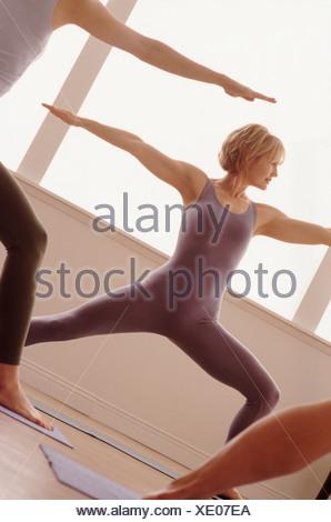 Woman doing a yoga pose - Stock Photo