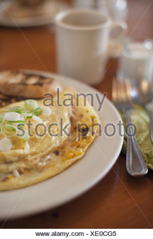 Close-up of cheese and onion omelette breakfast with toast - Stock Photo