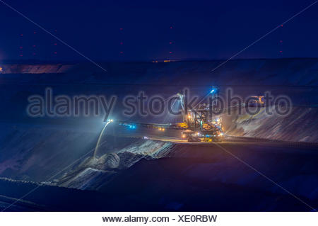 Germany, Juechen, lighted spreader at brown coal mining Garzweiler - Stock Photo