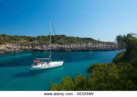 Sailing yacht in the bay of Cala Sa Nau, Mallorca, Majorca, Balearic Islands, Spain, Europe - Stock Photo