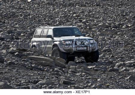 All-terrain vehicle driving on volcanic landscape, Spengisandur highland route, South Iceland, Iceland, Europe - Stock Photo