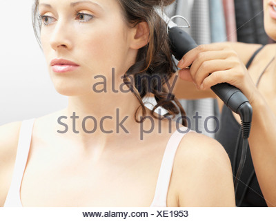 Model having her hair curled - Stock Photo