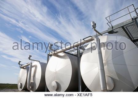 Tanks against blue sky - Stock Photo