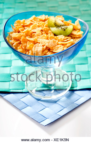 Cornflakes with kiwi slices in a bowl - Stock Photo