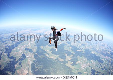 Female skydiver free falling above Leutkirch, Bavaria, Germany - Stock Photo