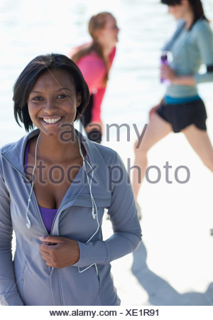 Smiling woman standing outdoors - Stock Photo