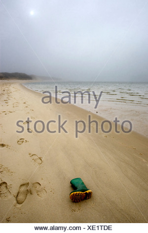 Rubber boot at beach, Sylt, Schleswig-Holstein, Germany - Stock Photo