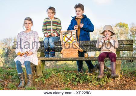 Children having picnic outdoors - Stock Photo