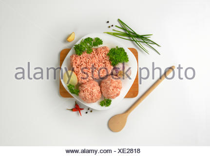 raw minced meat and meatballs - Stock Photo