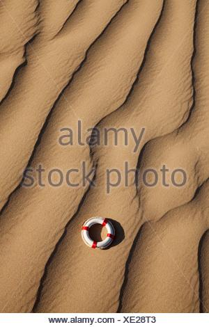 Lifebuoy in desert - Stock Photo