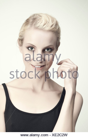 Young woman in tank top, portrait - Stock Photo