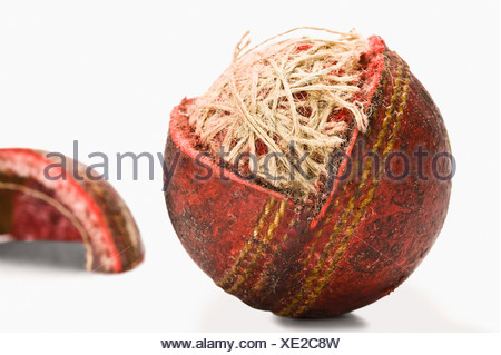 Close-up of a worn out cricket ball - Stock Photo