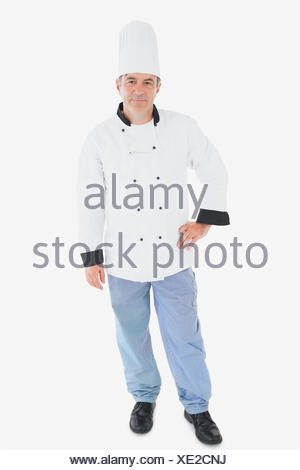 Chef in uniform standing with hand on waist - Stock Photo
