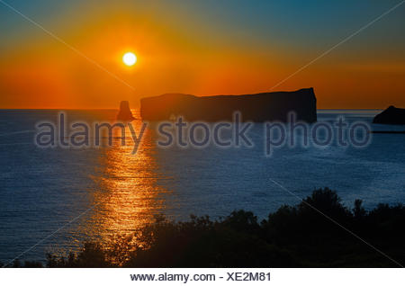 Rocher percé  (Percé Rock)  and the Atlantic Ocean at sunrise Percé  Quebec Canada - Stock Photo