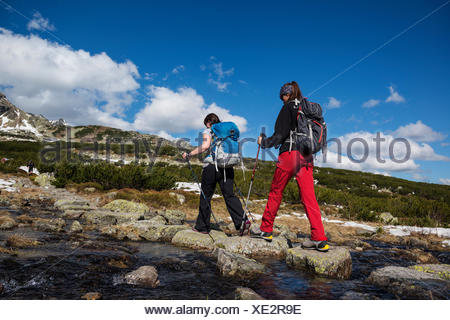Two female hikers hiking in Tatra mountains Poland - Stock Photo