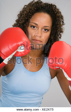 African woman wearing boxing gloves - Stock Photo