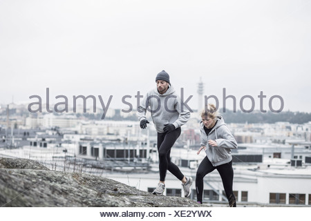 Sporty couple jogging together - Stock Photo