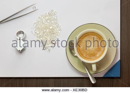 Coffee, Diamonds, Magnifying Glass and Tweezers - Stock Photo