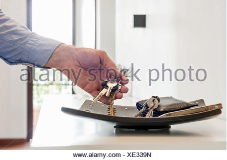 man catch the keys from the personal tray - Stock Photo