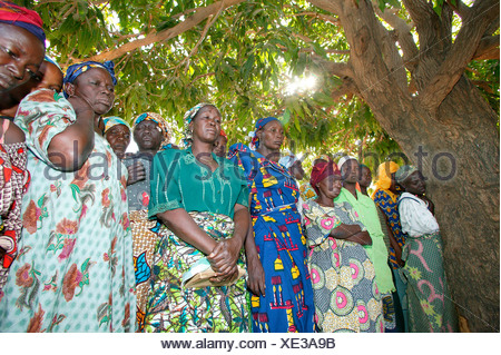 Women mourning at the funeral of a woman who died of HIV/AIDS, Garoua, Cameroon, Africa - Stock Photo