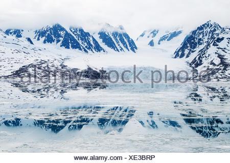 Monacobreen glacier, reflected in the water, Liefdefjorden, Spitzbergen, Norway
