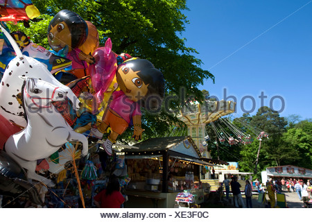 Balloons, chain carousel at back, traditional Waeldchestag, Frankfurt, Hesse, Germany, Europe - Stock Photo