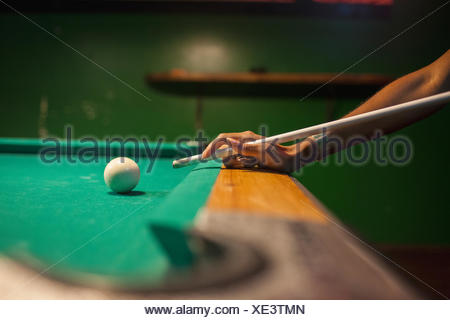 A young man playing pool. - Stock Photo