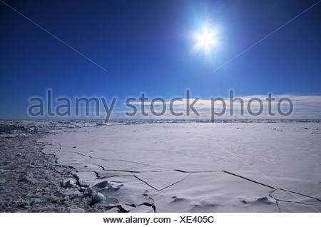 Sun over the breaking ice cover of the South Polar Ocean , Antarctica - Stock Photo