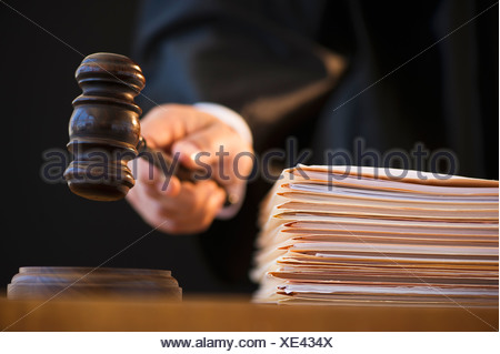 Judge holding gavel, close-up - Stock Photo