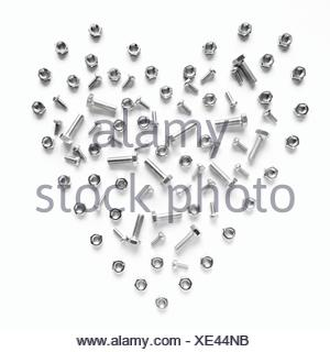 Heart Shape Made From Nuts And Bolts On White Background - Stock Photo