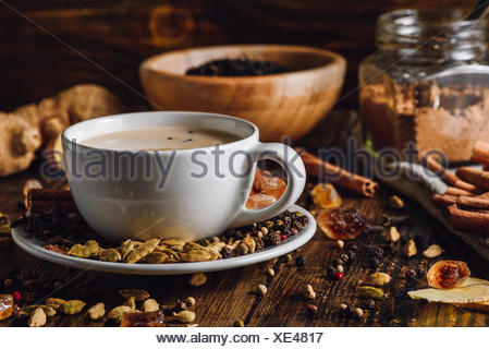 Masala Chai in White Cup with Different Spices - Stock Photo