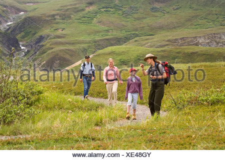 Female National Park Interpretive Ranger leads group on a *discovery hike* in the Eielson area Denali National Park Alaska - Stock Photo