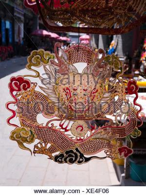 Dragon Cut-out, Panjiayuan Flea Market, Beijing, China - Stock Photo