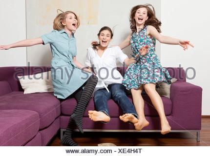 Three women jumping and jubilating - Stock Photo